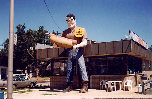 A Roadside Giant, also known as a Paul Bunyon Statue, once stood on the side of this hotdog joint in Cicero, Illinois. It now stands in the center of Atlanta, Illinois. July 11, 2001.
