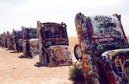 These antique Cadillacs, ranging from 1949 to 1963, create an eerie site along the Mother Road. Amarillo, Texas, July 16, 2001.