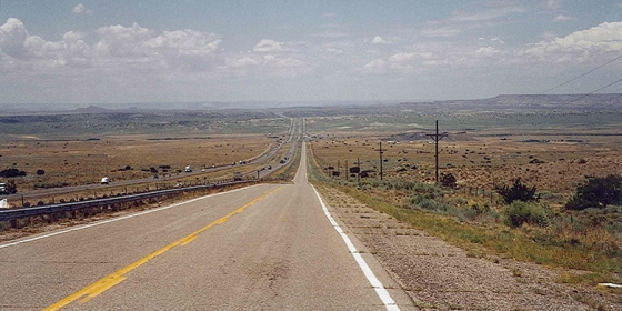 Route 66 cuts through the western desert of New Mexico, desolate and void of any human life save the traffic whizzing by on I-40. July 18, 2001.