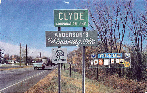 A vintage postcard I bought at Sherman's drug store in Clyde—it's no longer there. As for the image in the postcard—what os no longer standing at the Route 20 entrance to Clyde, Ohio, either. July 7, 2001.