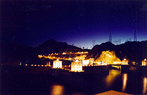 The Hoover Dam lit up in its Art Deco glory is reminiscent of a Mediaeval kingdom. July 19, 2001.