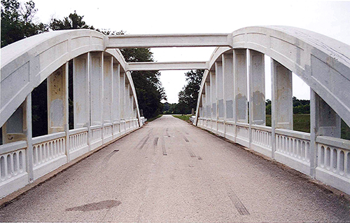 The rainbow bridge outside of Galena, Kansas. The form of this bridge is slowly eroding away from American highways and roads. This one was in the process of being restored. July 13, 2001.