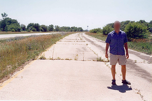 Kyle standing on an original stretch of Route 66 just north of Shirley, Illinois. July 11, 2001.