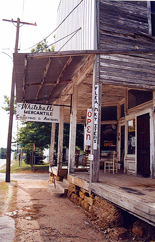 The Whitehall Mercantile in Halltown, Missouri, was where Kyle decided we needed a portable radio. Since our van didn't have a radio, despite the fact that Kyle had purchased one to install, our AM only radio was the nay contact we had with the radio airwaves of the midwest. July 13, 2001.