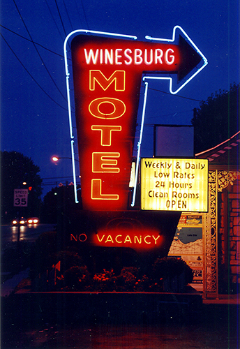 The classic neon sign tempting travelers off Route 20 into a mom-and-pop refuge glowed with the comfort of a sunset. The sign is no longer there. July 7, 2001.